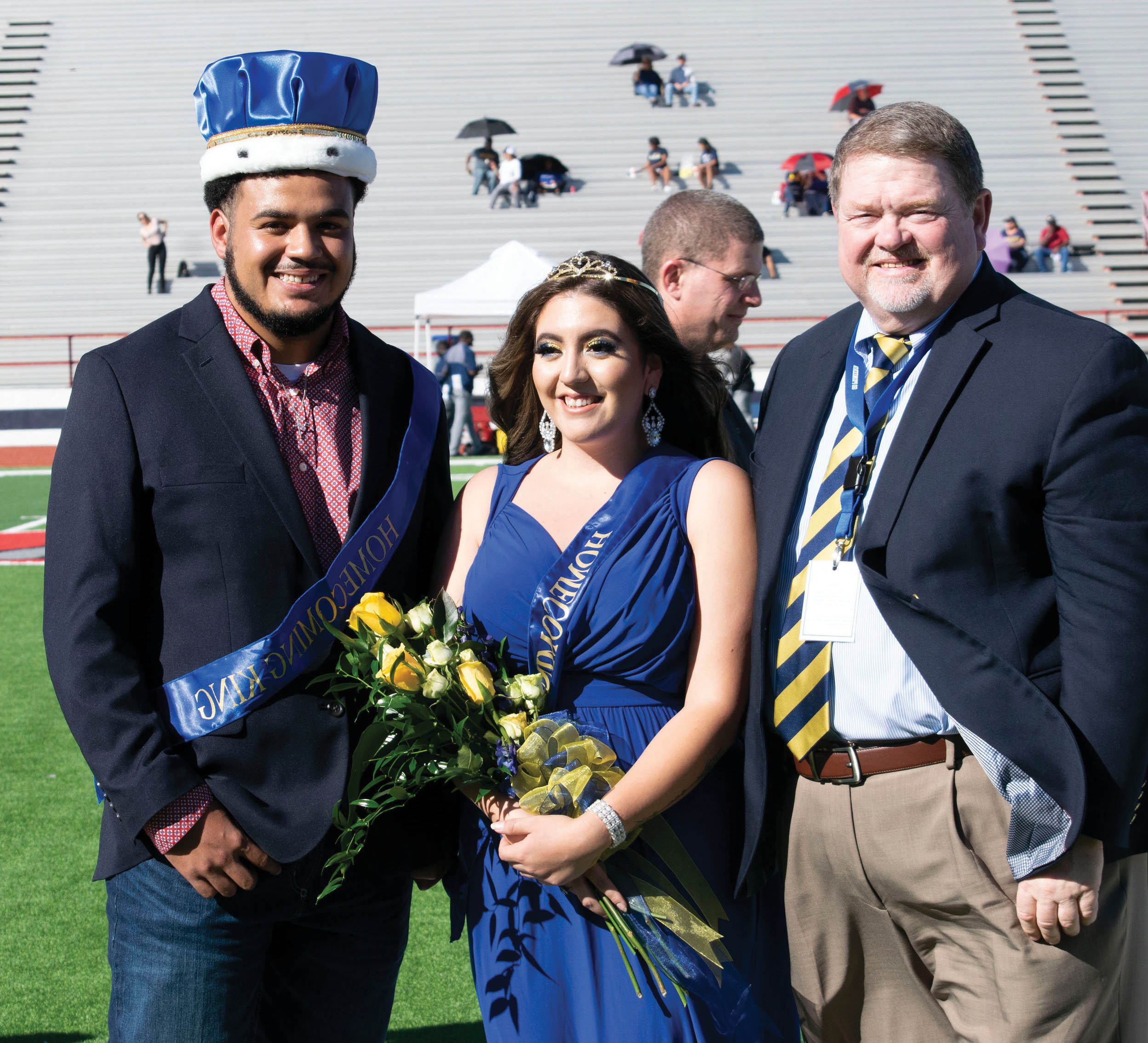 Dr. Hall with homecoming queen Dakota Schmig and king Marc Wallace